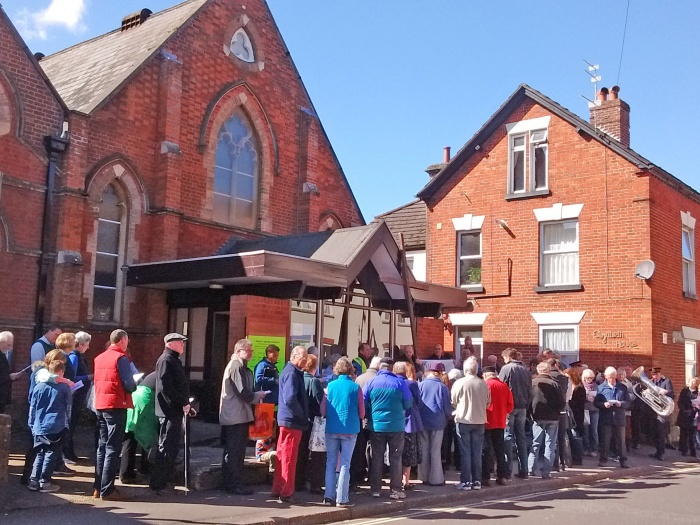 Ecumencial walk of witness on Good Friday pauses outside Wesley Centre-